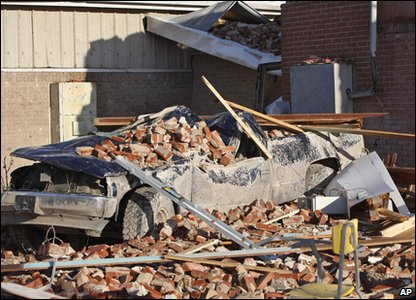 Tornadoes rip through America - truck is covered in rubble outside a school in Oklahoma