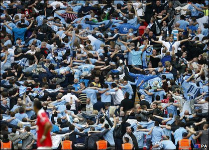 FA Cup - Manchester City 1-0 Manchester United - City fans celebrate with the Poznan dance