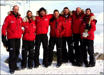 The trek team relax and smile after completing their North Pole trek