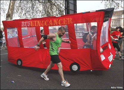 Runners dressed up as a bus