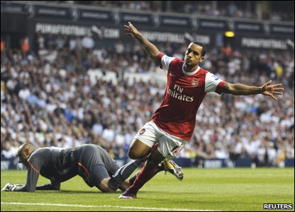 Theo Walcott celebrates after scoring a goal