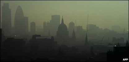 St. Paul's Cathedral is seen among the skyline through the smog in central London on 22 April 2011