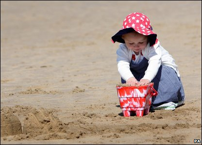 Lily builds a sandcastle in Blackpool