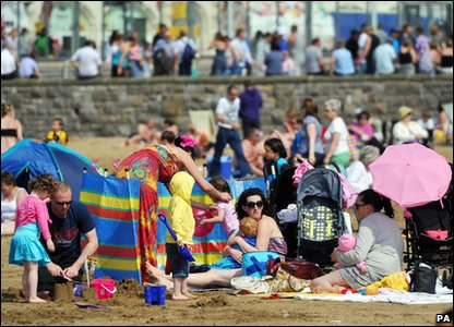 People enjoy the sun in Weston Super Mare