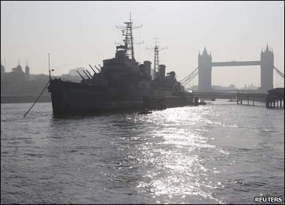 HMS Belfast on the River Thames during the morning haze