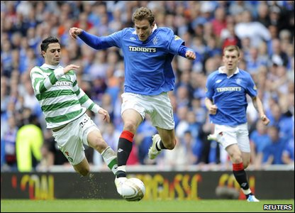 Rangers 0-0 Celtic - Rangers' Nikica Jelavic is challenged by Celtic's Beram Kayal