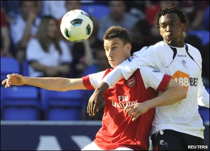 Bolton 2-1 Arsenal - Arsenal's Laurent Koscielny battles Bolton's Daniel Sturridge for the ball