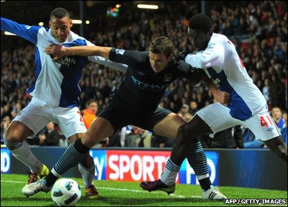 Manchester City forward Edin Dzeko (Centre) vies with Blackburn Rovers defender Jermaine Jones (Left) and forward Mame Biram Diouf (Right) during the Premier League match at Ewood Park, Blackburn