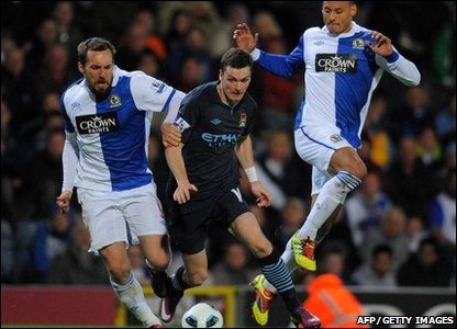 Manchester City midfielder Adam Johnson (Centre) goes for the ball against Blackburn Rovers defenders Jermaine Jones (Right) and Gael Givet during the Premier League match at Ewood Park, Blackburn