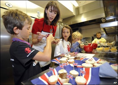 Samantha Cameron, wife of Britain's Prime Minister David Cameron, bakes cakes for the Downing Street Royal Wedding street party with a group of school children who will be attending the party on 29 April.