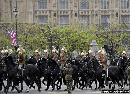 Members of Britain's armed forces ride past the Houses of Parliament during a dress rehearsal for Prince William and Kate Middleton's royal wedding.