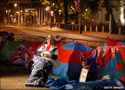 Royal fan Terry Hutt sits outside his tent at Westminster Abbey