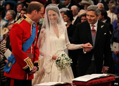 The couple at the altar of Westminster Abbey, with Kate's father Michael Middleton.