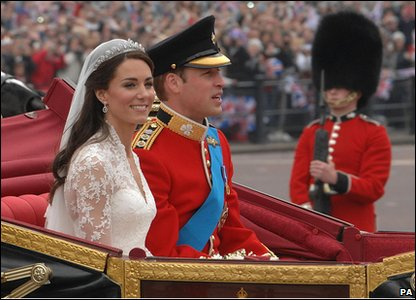 William and Kate leaving in a carriage.