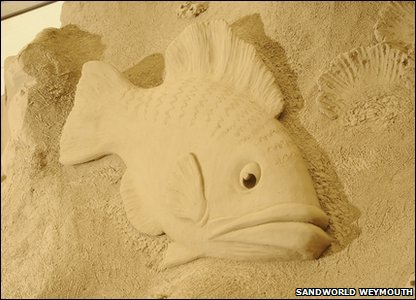 Fish sand sculpture