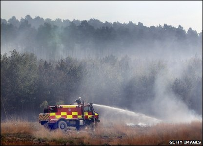 These firefighters are trying to control the blazes in Swinley Forest near Crowthorne in England