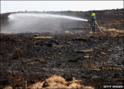 About 60 firefighters have been tackling a massive moor fire near Mytholmroyd in West Yorkshire.