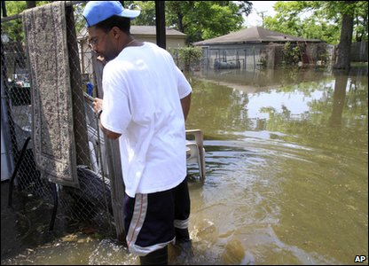 Man looks at flooding in his garden in Memphis in America