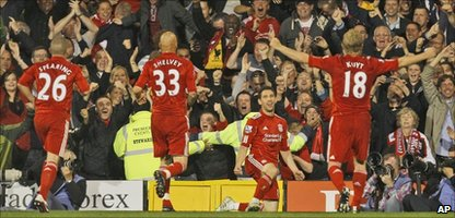 Liverpool's Rodriguez Maxi, second right, celebrates after scoring a goal against Fulham