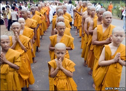 Buddhist children praying