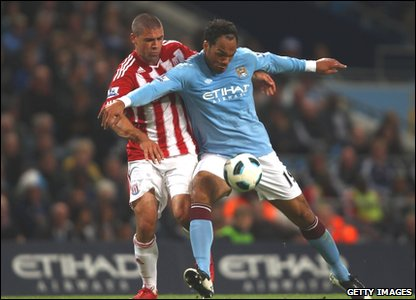 Joleon Lescott of Manchester City in action with Jonathan Walters of Stoke City