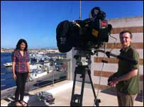 Sonali and Newsround cameraman Darryl prepare to broadcast from the roof of their hotel