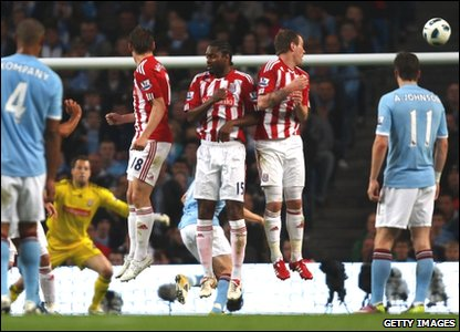 Carlos Tevez of Manchester City scores his second goal from a free kick