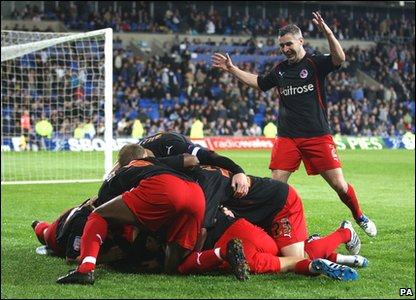 Reading's Jobi McAnuff is mobbed by his team mates after he scores their side's third goal of the game