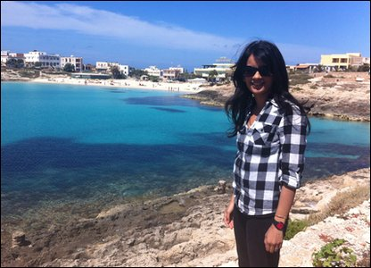 Sonali on the beach at Lampedusa
