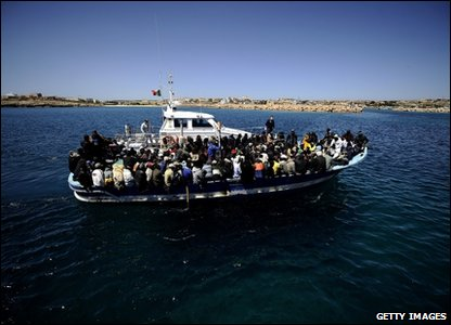 Packed boat arriving at Lampedusa