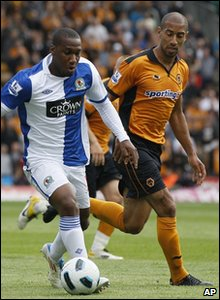 Wolverhampton's Karl Henry, right, goes for the ball with Blackburn's David Hoilett during their match at Wolverhampton's Molineux Stadium