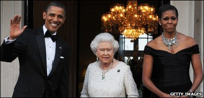 Barack Obama waves as he and his wife Michelle meet the Queen.