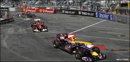 Sebastian Vettel of Germany leads Ferrari's Fernando Alonso of Spain and McLaren's Jenson Button of Britain