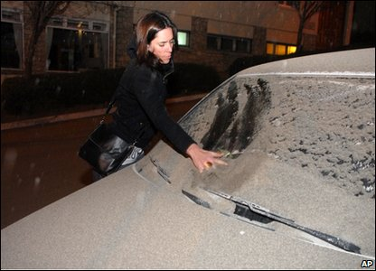 Woman cleans car after eruption at the Puyehue-Cordon-Caulle volcano range in southern Chile