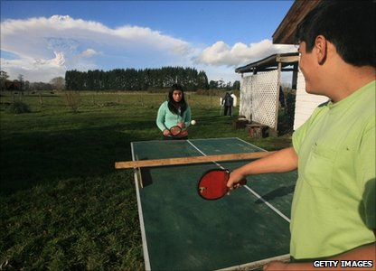 Playing table tennis while in the background there's a cloud from the eruption at the Puyehue-Cordon-Caulle volcano range in southern Chile