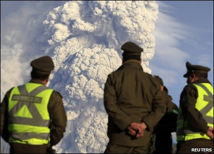 Police officers watch eruption at the Puyehue-Cordon-Caulle volcano range in southern Chile