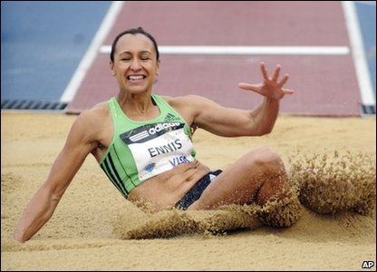 Jessica Ennis lands after doing the long jump