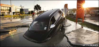 A car stands in water in Christchurch, New Zealand