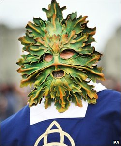 Man wearing a Green Man mask at Stonehenge, Wiltshire, on 21 June 2011