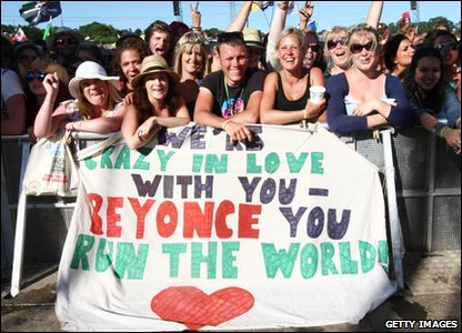 Fans with a Beyonce banner at Glastonbury