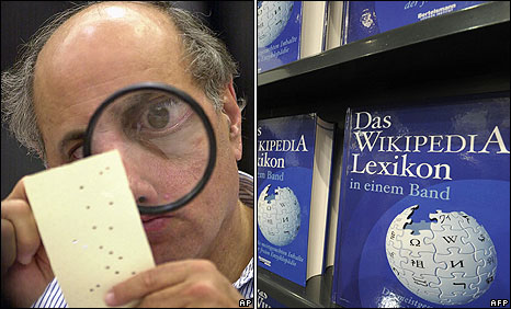 Examining a disputed ballot paper at Broward County Courthouse in Fort Lauderdale, Florida on 24 November 2000 (left): Copies of a one-volume Wikipedia Encyclopaedia on display at Frankfurt Book Fair on 16 October 2008.