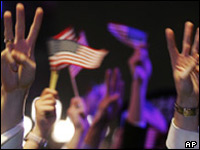 Bush supporters wave at a victory rally
