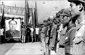 Red Guards lined up in Peking, China in front of a portrait of Mao Tse-Tung in 1966. (AP)