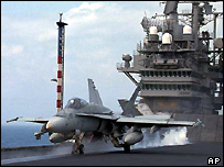 F/A 18 Hornet jet fighter takes off on the deck of the USS Independence in the Taiwan Strait, 1996