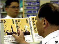 Japanese man examines a history textbook