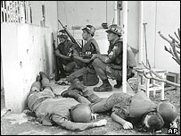 US military police take cover from Vietcong guerrillas at the entrance to the US consulate in Saigon on the first day of the Tet Offensive, Jan. 31, 1968.