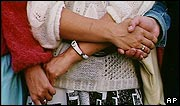 Women hold hands in the human chain linking Baltic states