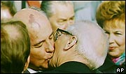 Soviet leader Mikhail Gorbachev greets East German leader Erich Honecker