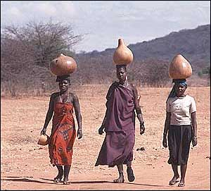Women carrying water in Tanzania