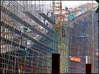 Workers build a huge indoor ski-slope on the outskirts of Shanghai, China. May 2002 (AP)